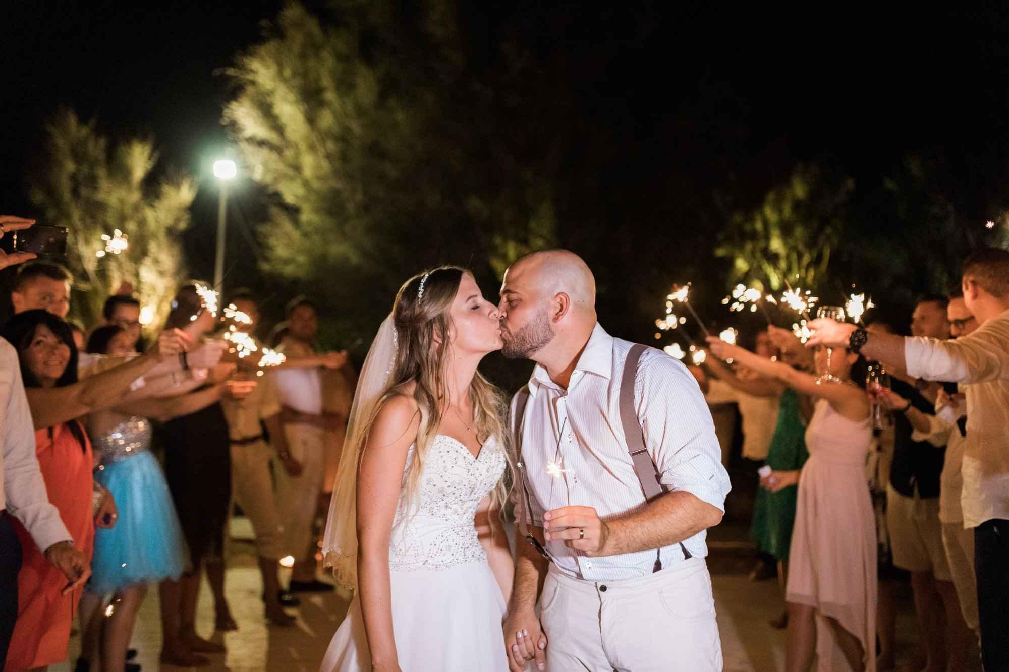 Couple Enjoys Romantic Sunset Wedding by the Sea in Monopoli